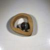 Greifling aus Holz mit Edelstein
